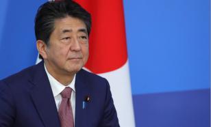 Премьер Японии выступил за продление режима ЧС