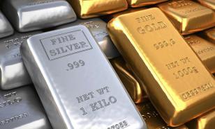Россиянам посоветовали покупать золото