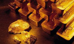 Цена на золото еще будет падать, но в долгосрочной перспективе оно - хорошее вложение - аналитик
