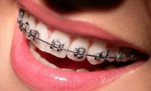 Почему вырастают некрасивые зубы?