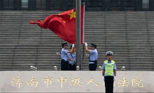 """Китайские СМИ обвинили Запад в провокации """"цветных революций"""""""