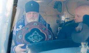 """Святой водой """"обработали"""" Минск с вертолета"""