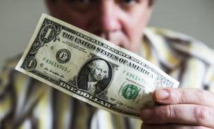 Биржевой курс доллара поднялся выше 77 рублей впервые с апреля