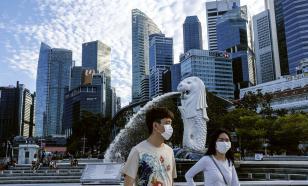 Гостей Сингапура заставят носить электронные браслеты