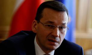 Польский премьер: Макрон безответственно относится к диалогу с Россией