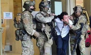 """Захвативший отделение банка в Киеве просил называть его """"святым духом"""""""