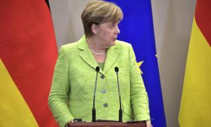 Меркель обещала, что в Германии не будет дефицита наличных денег
