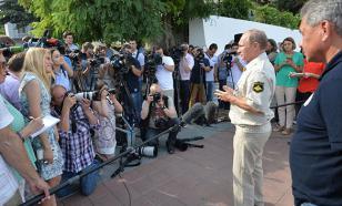 СМИ: Запад спокойно отреагировал на поездку Владимира Путина в Крым