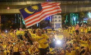 """Китайцы поднимают Малайзию на дыбы из-за погибших в """"Боинге"""" сограждан – мнение"""