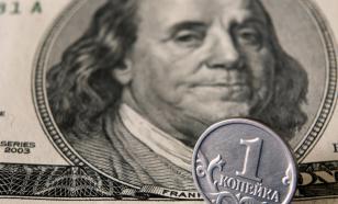 Впервые с 6 марта курс доллара опустился ниже 70 рублей