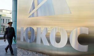 Акционеры ЮКОС отзывают иски к России по всему миру