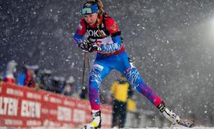Российским биатлонистам вернули флаг России на форму