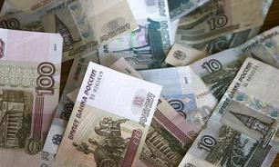 Bloomberg и Fitch: Российскую экономику спас ЦБ, она начнет расти