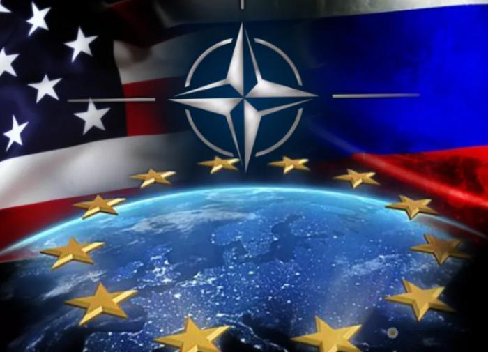 флаги США, НАТО, ЕС и России
